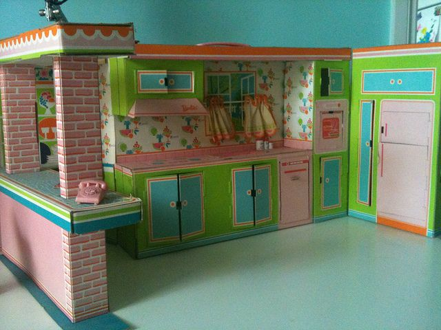 Barbie's Kitchen I received this in 1964 for Christmas.  It had to be put together and was made of thick cardboard.  I was in the middle of the chickenpoxs.  My Dad put it all together for me with a bit of my help.  When I was done with my nap, chickenpoxs are tiring it was all together thanks to Dad.