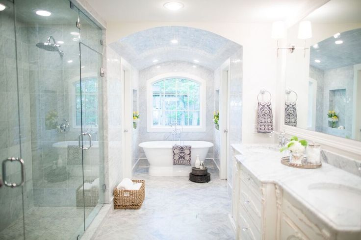 I'm in love with this bathroom with white marble countertops and marble floors and the white cabinets
