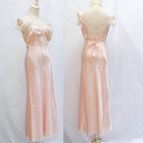 A rare label, this original 1930s-40s gown by Vendome enchants in blush pink rayon satin, trimmed out in delicate lace with French off-shoulder