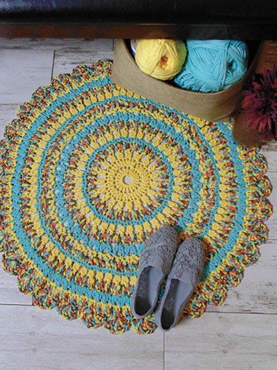 "CROCHET ~ 3 great rugs to stitch using Bernat Maker Home Dec #5 bulky-weight yarn. Designs include Modern Flair - 20""H x 30""W; Sunny Days - 32"" in diameter; and Woodberry"