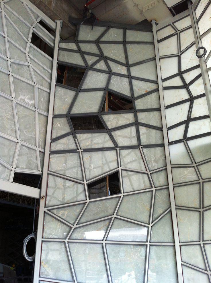Mounting of backlit White Onyx. Raffless Hotel Zorlu Center