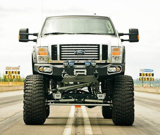 lifted truck..he would love to drive off in and crush a few cars ha ha lol