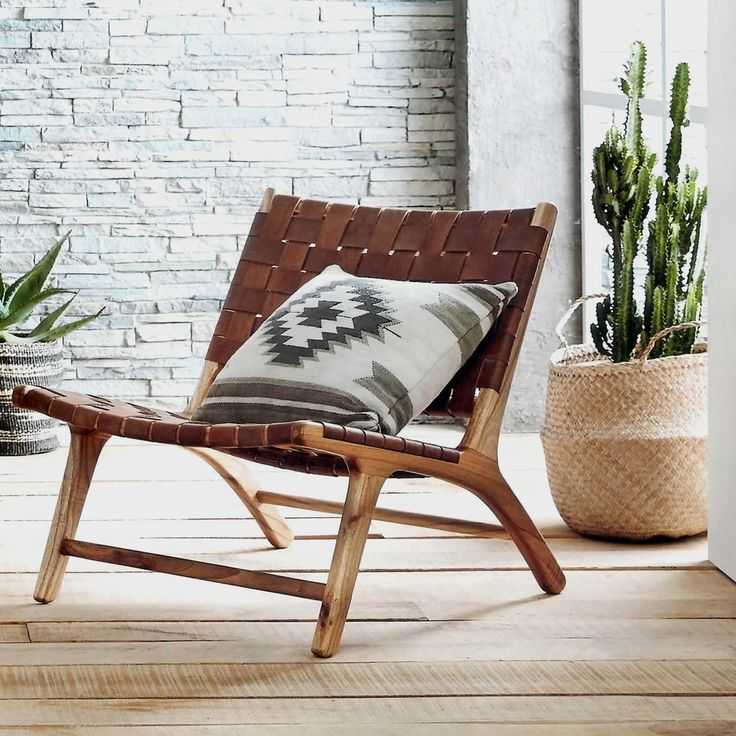 Our low, woven leather chair makes lounging an inescapable temptation. Leather…