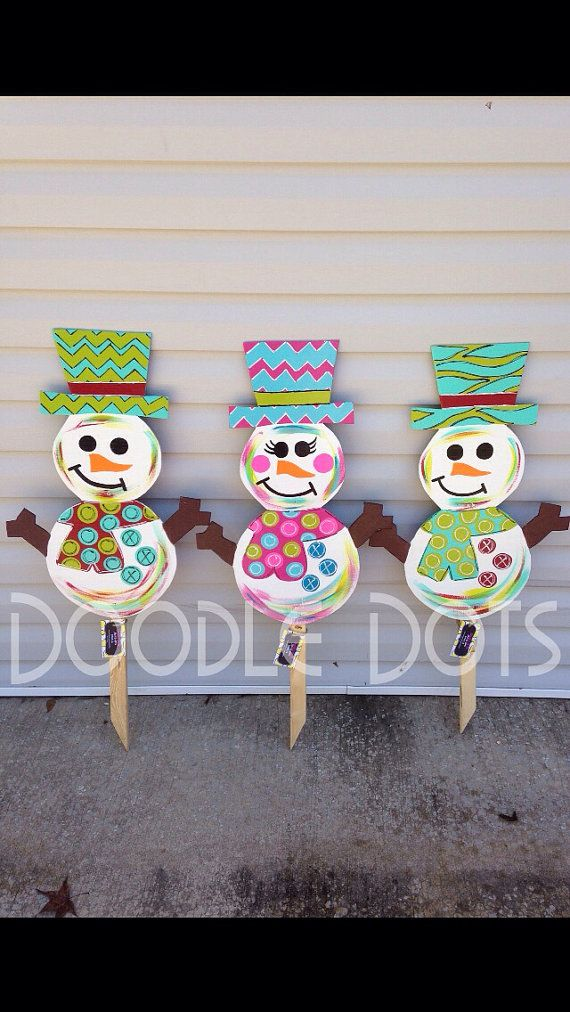 Snowman/woman yard stake by DoOdLeDotsAnDmOre on Etsy