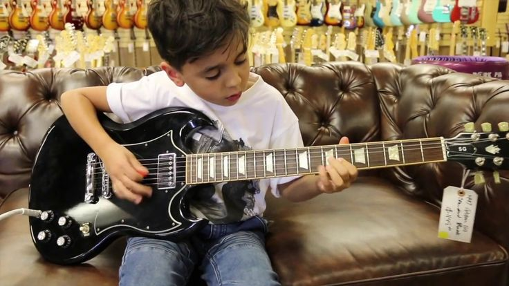8-year-old Jayden Tatasciore playing our Gibson SG Standard here at Norm...