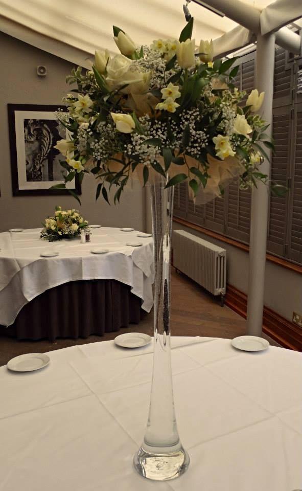 Floral arrangement set on a lily vase.
