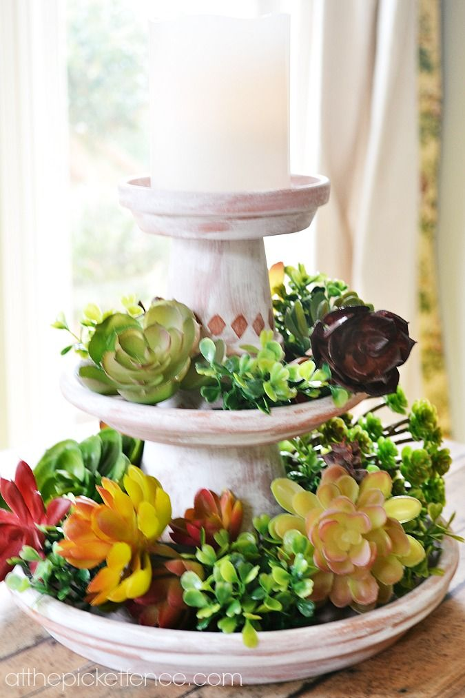 So simple and elegant! This tiered clay pot centerpiece looks so pretty with faux succulents but would be easy to switch out seasonally. Use real succulents, candle on top.