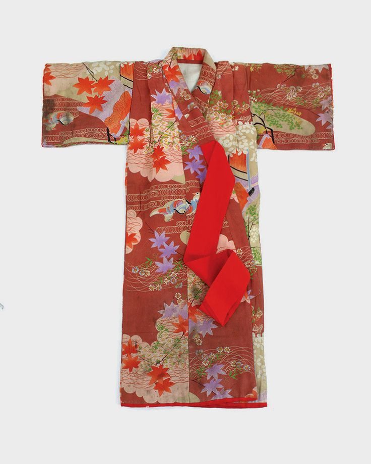 This is a colorful children's Kimono, made to wear for celebrations. It is silk, lightly padded, easy to tie closed, and it features bright, vibrant patterns. Please note that this piece is worn and h