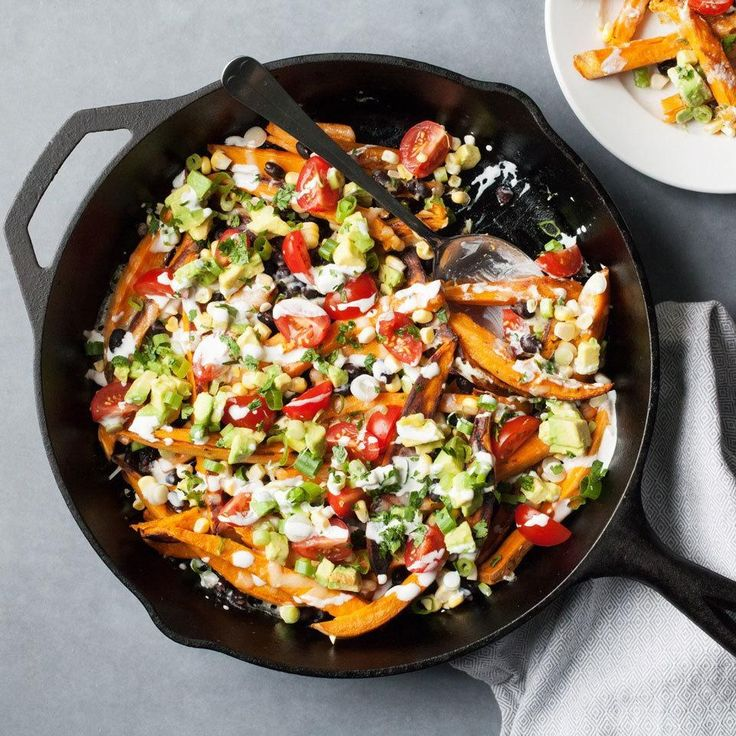 We load our nachos up with the good stuff for game-day grub without the guilt. Sweet potato fries, corn, tomatoes, avocado—what's not to love? #FallFresh