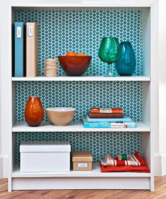 No sew craft - decorate the back of a bookshelf with pretty fabric and double sided tape.