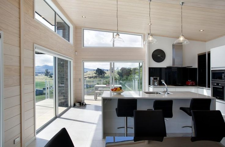 Open-plan kitchen and living area. Modern appliances and gib walls gives the kitchen clean lines