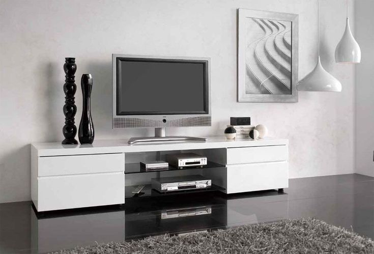 This modern TV stand will not leave you and your guests indifferent  The TV  stand is made in rich white finish with grey accents  Drawers with hand. This modern TV stand will not leave you and your guests