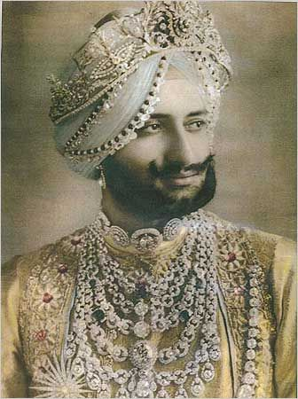 The Maharaja of Patiala, wearing a diamond and platinum parade necklace created by Cartier in 1928.
