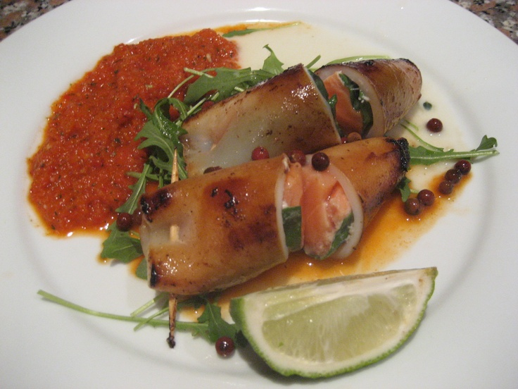 squid stuffed with basil and salmon with roast capsicum coulis and buttermilk sauce
