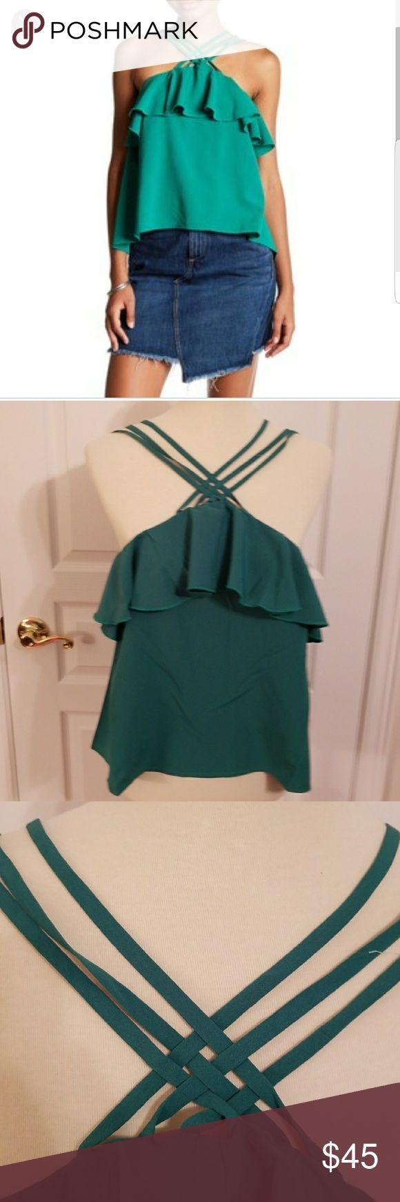 "Romeo & Juliet Couture green Strappy top sz L NWT Super cute green Strappy ruffle top by Romeo & Juliet Couture. Crisscross straps at front and ruffle detail at bustline. Elastic at back bustline for stretch. NWT. Jewel tone emerald color. Approx 22"" shoulder to hem bust approx 37"" (unstretched) Romeo & Juliet Couture Tops"