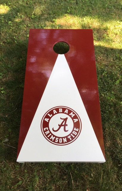 2 Official size Alabama Crimson Tide cornhole boards They are made using a premium 2x4 frame and cabinet grade or sanded plywood (depending on availability) playing surface. Painted, decals applied, sealed and ready to use. Each board has folding 2x4 legs secured with 3/8x3-1/2 in. bolts with washer and nuts .They are built when ordered. Bags are not included.  Regulation cornhole board dimensions Solid Plywood playing surface  Hand crafted  Made in the USA  24 x 48 plywood playing surface…