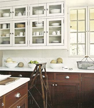 white upper cabinets and dark lower cabinets