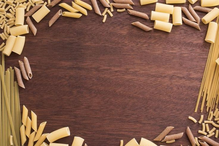 Dark smooth wooden background surrounded by dry pasta in various types and lengths. Includes copy space. - free stock photo from www.freeimages.co.uk