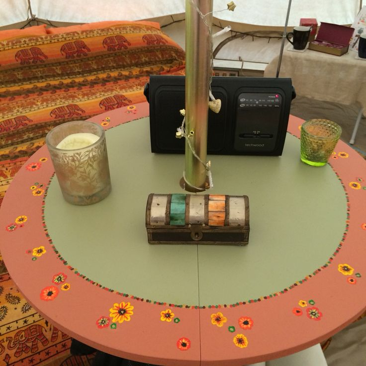 My hand painted table, clamps onto the central pole of our Bell tent.