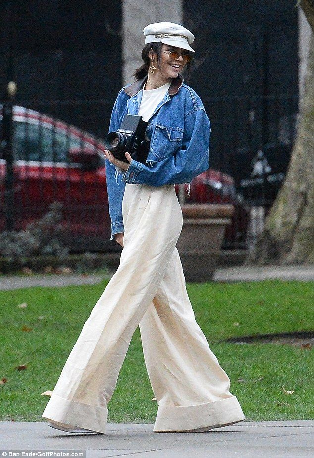 C'est chic:The supermodel exuded Parisian irreverence in a pair of white wie-leg trousers and a Nineties-inspired cropped denim jacket