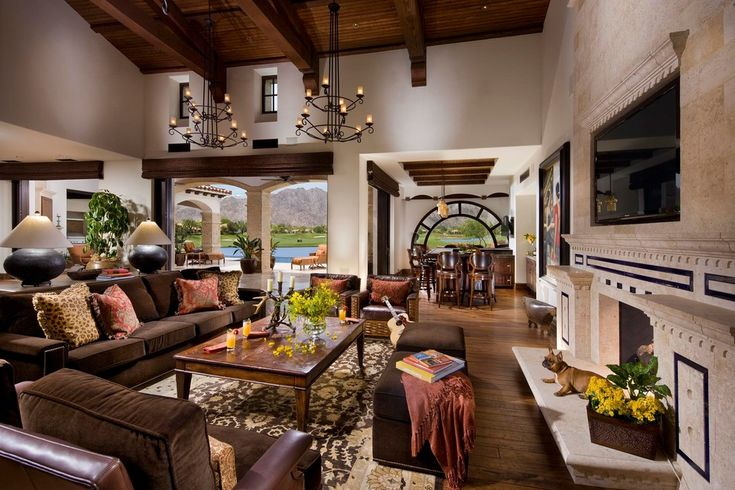 Lovely Spanish Decorative Plates Image Decor in Living Room Mediterranean design ideas with Lovely arch window area rug beams beige wall chandelier coffee table cushions dining