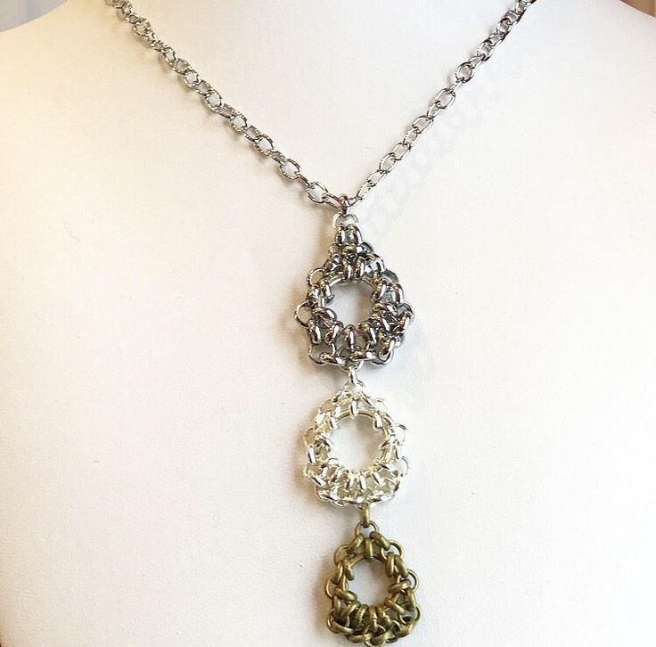 Sensory pendant in three colours of chainmail. Handmade by IronLaceDesign. #ironlacedesign #chainmail #sensory #fidget https://www.etsy.com/ca/listing/578424650/draped-chainmail-daisy-pendant