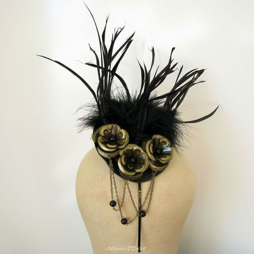 How about this snazzy number for Melbourne Cup.... Black & Gold Flower Feather Fascinator Headband Melbourne Cup Horse Racing  $124.95