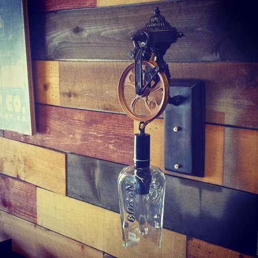 We just love this custom 209 Gin bottle wall sconce made from a recycled bottle, pulley and brass hardware.  Check out moonshinelamp.com for lots more recycled bottle pendant lamps, sconces and chandeliers.