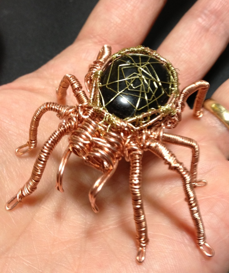 I made the spider made of copper wire and polished rock