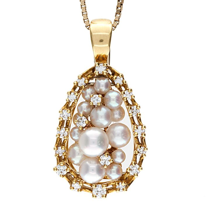 Stunning 18K yellow & white gold combination interchangeable pendant/ pearl enhancer with a hinged bale and set with 12 round full cut diamonds and pictured with a clustered style pearl insert along with 4 other sets of stone inserts and a high polish finish, This pendant will look great for any occasion!