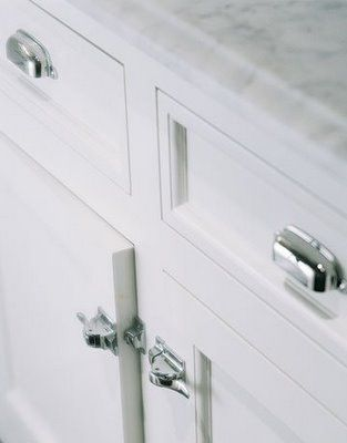 Christopher Pea Hardware In A White Kitchen With Marble Countertops