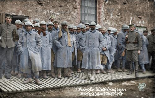 French prisoners guarded by a German soldier, Verdun, March 1917