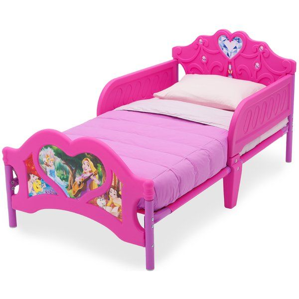 Make her bedroom magical with this Disney Princess 3D Toddler Bed from Delta Children. Featuring enchanting decals of Cinderella, belle, Ariel and Grapnel, plus a three-dimensional footboard with heart-shaped detailing, this colorful bed will be the centerpiece of any young girl's bedroom. For additional security, the Disney Princess 3D Toddler Bed from Delta children is the perfect kid-sized height and has two attached guardrails, so you can rest easy knowing your princess will sleep safely…