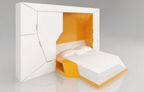 Um quarto numa caixa. Cama.