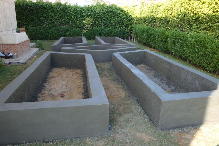 Raised Garden Bed made of block and covered with concrete.  http://thejasminegate.com/2013/10/