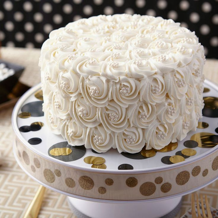 White can excite when the cake is decorated with deeply-ridged rosettes, set off by white Sugar Pearl centers. Introduce your color theme by placing the cake on the Display Your Way Customizable Cake Pedestal, which features see-through covers on plate and rims for adding decorative paper, ribbon and more.