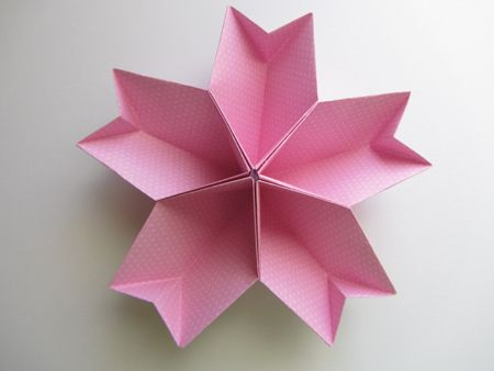 Origami cherry blossom.  Imagine a large one holding a variety of candies at your candy bar.