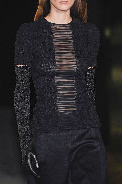 The center panel and sleeve slits. A tissue-thin shirt in a contrast color worn under this sweater will utilize these features in the best way. (-Brisk Converge) Alexander Wang Black Knit F12