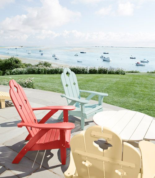 Ahhhh someday!!!! Oceanfront Patio Colorful Adirondack chairs from Charleston Gardens brighten this