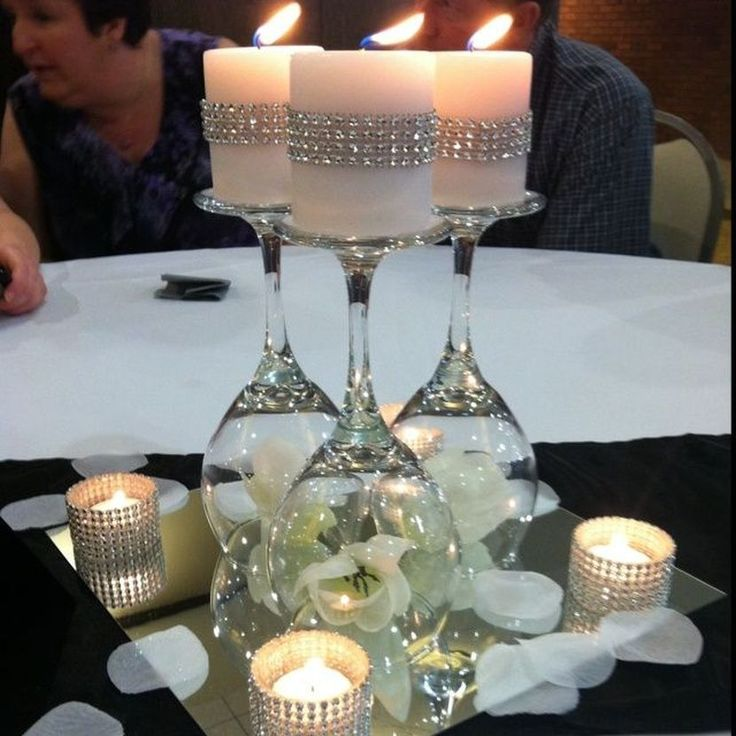 Impressive DIY Wine Glasses On a Mirror Wedding Table Centerpiece With Candles and White Flowers