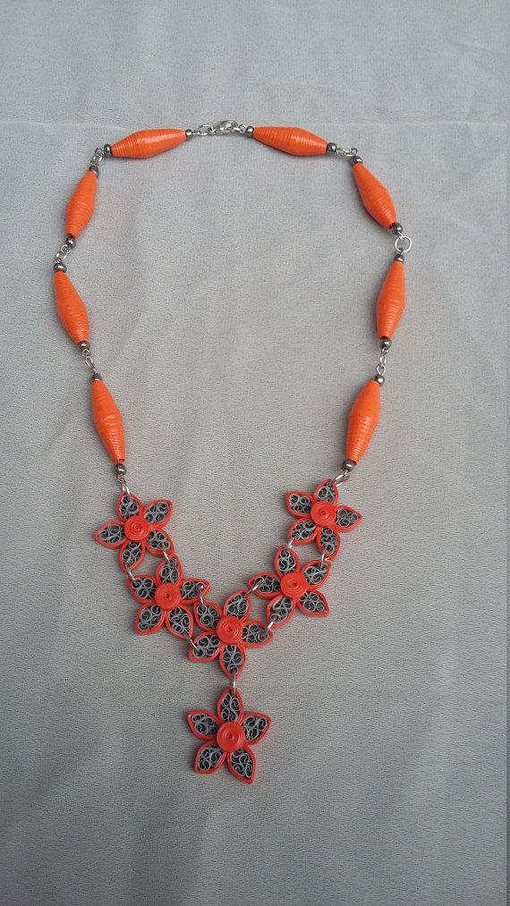 Orange quilling necklace, quilling paper necklace, quilling paper flower, boho necklace, quilling necklace. Made of paper with quilling techniques in Orange and grey,paper beads and seed beads. Varnished with glossy water based varnish. Short necklace, neckline. Please note that the color may vary depending on your computer monitor setting.   Shop this product here: spreesy.com/Crochetbutique/52   Shop all of our products at http://spreesy.com/Crochetbutique   Pinterest selling powered by…
