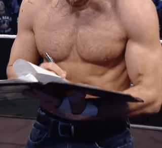 Dean Ambrose signing The Contract to make The Intercontinental Championship Match Between Kevin Owens an Dean Ambrose Official