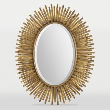 A great golden fringe frame surrounds abeveled oval mirror. Made from metal with astunning antique gold leaf finish.