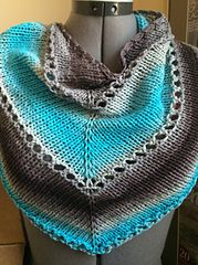 http://www.ravelry.com/projects/TanisKnits/the-age-of-brass-and-steam-kerchief
