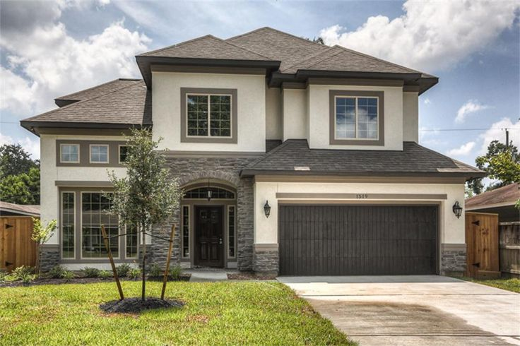 1519 CHANTILLY LN HOUSTON, TX 77018: Photo A beautiful stone and stucco facade is enhanced by lush landscaping and a new 8 foot privacy fence with gates on both sides.