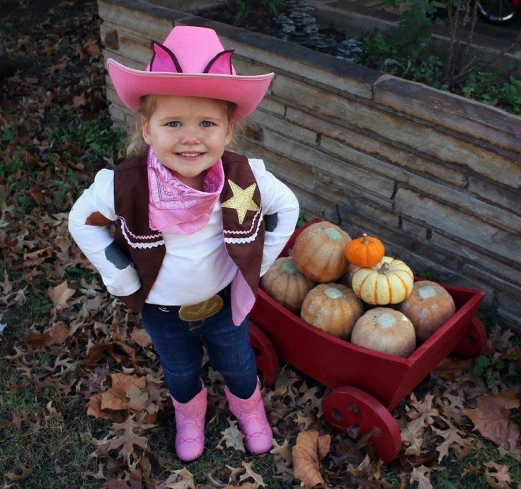 """Sheriff Callie Halloween costume idea! Also perfect for dress up, or a themed birthday party! We got the handmade vest, belt, hat, and handkerchief from a lovely Etsy shop titled. """"BDusty"""" for $40 then bought the pink boots from Walmart $12, the long sleeve white shirt at Walmart $5, colored fabric paint at Hobby Lobby to """"spot"""" the white shirt mimic Callie's calico, and used a pair of jeans from home!"""