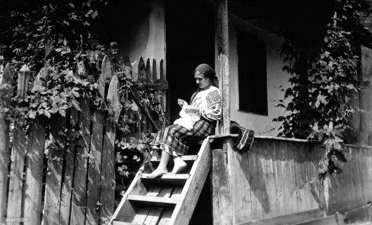 Moldova Romania woman traditional house porch