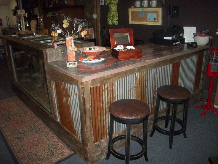 Rusted corrugated metal with a concrete top could bring for Concrete bar top ideas
