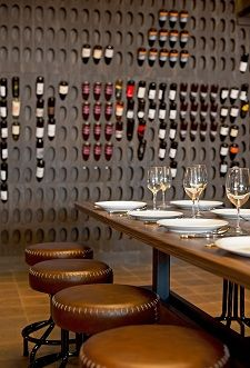 Trenchermen (Chicago): The dining room's entire back wall is covered with a stained cedar wine rack.