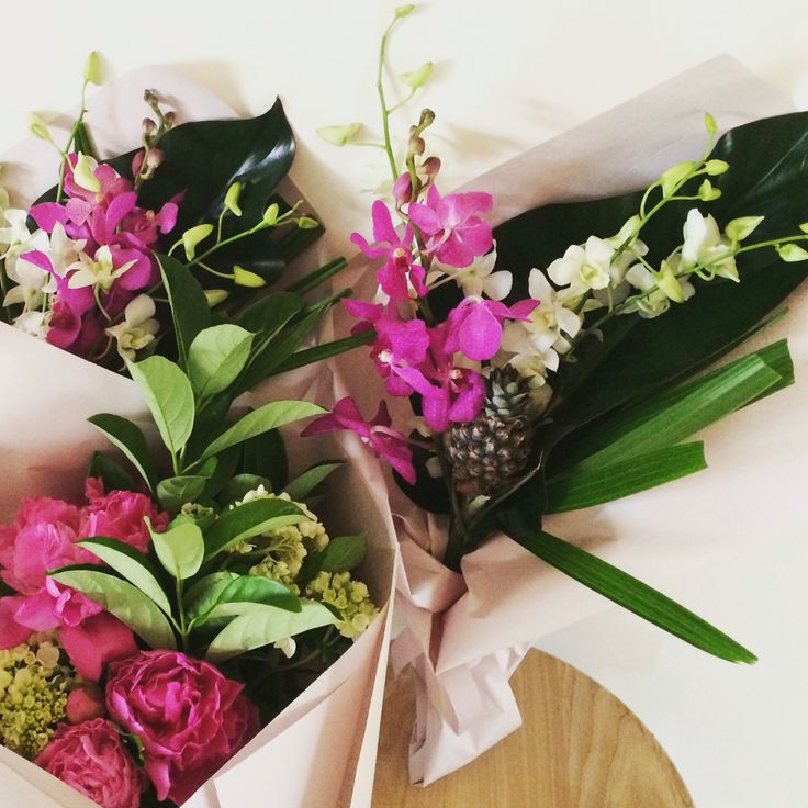 Summery orchids, peony roses, hydrangeas and mini pineapples. Posies by Y Style www.ystyle.com.au